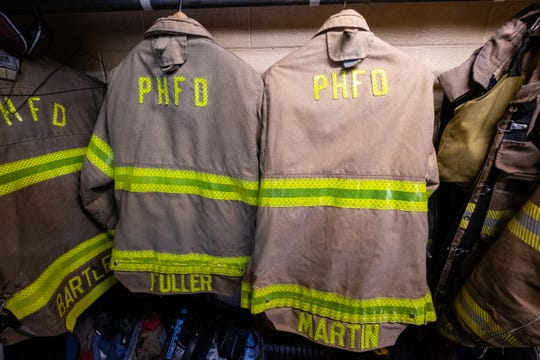 Jackets for firefighters/EMTs April Fuller and Jackie Martin hang at Port Huron Fire Department's central station.