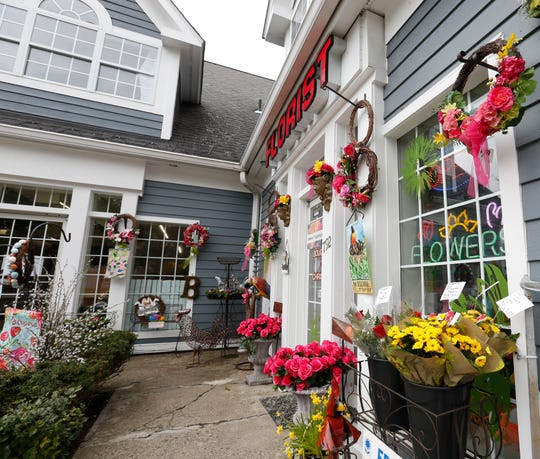 Flowers available to pick up from Bouquets by Christine Florist in Hopewell Junction on March 25, 2020. Customers can contact her to arrange credit card pickup or leave money in a drop box which limits potential for contamination and exposure to the coronavirus.