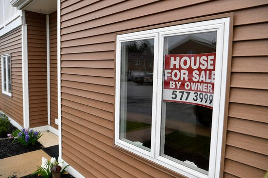 A for sale sign in the window of an empty home on Copperwood Court in West Manchester Township, Showings and open house events for real estate sales have been cancelled due to the pandemic while home buying is showing a downward trend, Wednesday, March 25, 2020.John A. Pavoncello photo