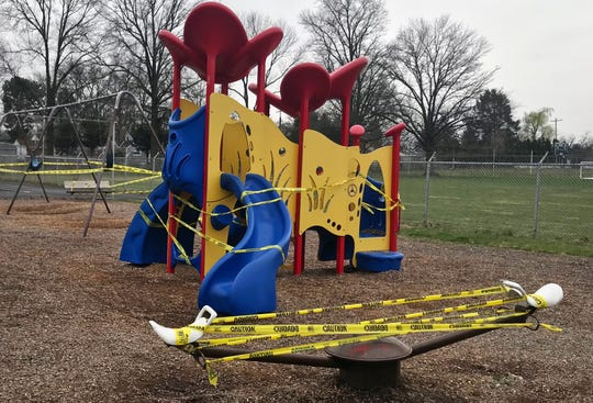 Caution tape covered the entrances at Maple Street Park in Lemoyne on Wednesday, as the borough is trying to encourage social distancing. Fences were put up around the basketball court, and entrance to the tennis court was also closed. The parks will be closed until further notice.