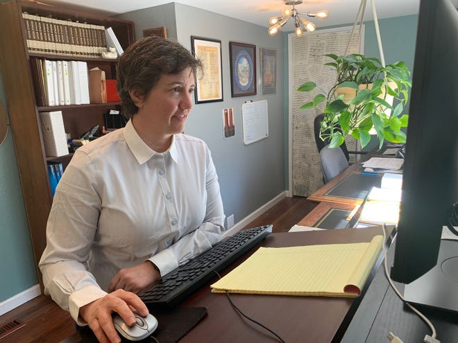 Nicole Harvey, an attorney with the Reno law firm of Blanchard, Krasner & French shown here in her home study, has begun offering electronic wills to serve clients during coronavirus social distancing. Nevada is one of a handful of states where e-wills are legal.