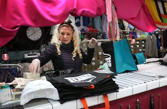"Jessica Scheider puts together a ""mystery bag"" while in her store Junkee Clothing Exchange in Reno on March 25, 2020."