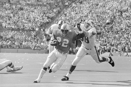 Buffalo's Mike Stratton chases down Miami's Mercury Morris in a 1972 game at the Orange Bowl.