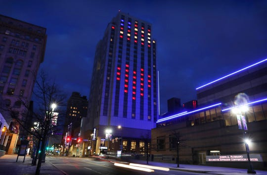 Lights in the windows of the Hyatt Regency Rochester at 125 E Main Street are lit up to show a giant American flag and a giant heart in downtown Rochester Tuesday night, March 24, 2020. Staff at the hotel wanted to show support for the city and the country in these challenging times of the coronavirus pandemic.
