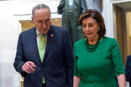 FILE - In this March 12, 2020, file photo Senate Minority Leader Sen. Chuck Schumer of N.Y., and House Speaker Nancy Pelosi of Calif., walks together as they head to a lunch with Irish Prime Minister Leo Varadkar on Capitol Hill in Washington. (AP Photo/Susan Walsh, File)
