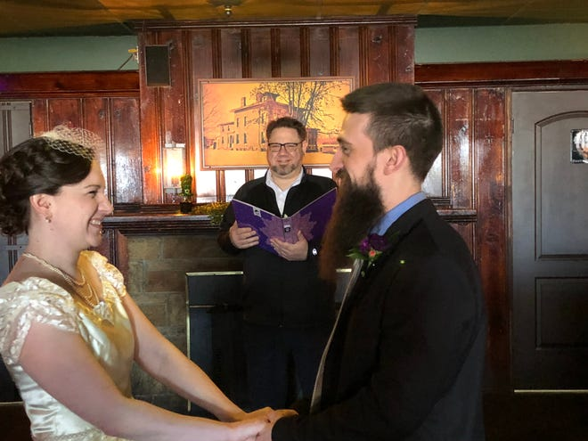 Don Bush, center, officiated the wedding of Chelsea and Nate Jay at his restaurant, the Union Tavern in Irondequoit. They took care to maintain safe spacing during the coronavirus epidemic.