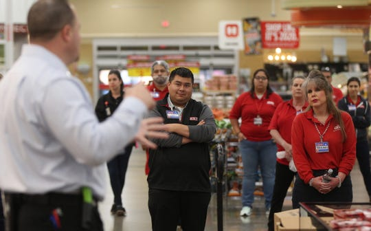 Nick George, far left, speaks to the team of H-E-B workers before the doors open to customers in San Angelo on Wednesday, March 25, 2020.