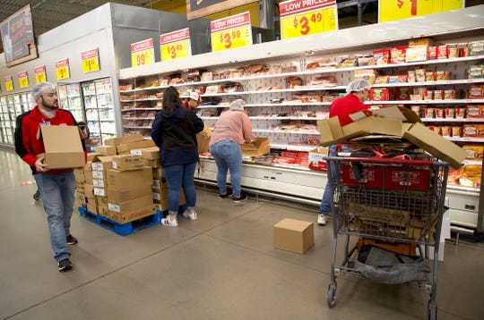 Workers at the H-E-B store on the west side of San Angelo stock shelves before the doors open to customers Wednesday, March 25, 2020.