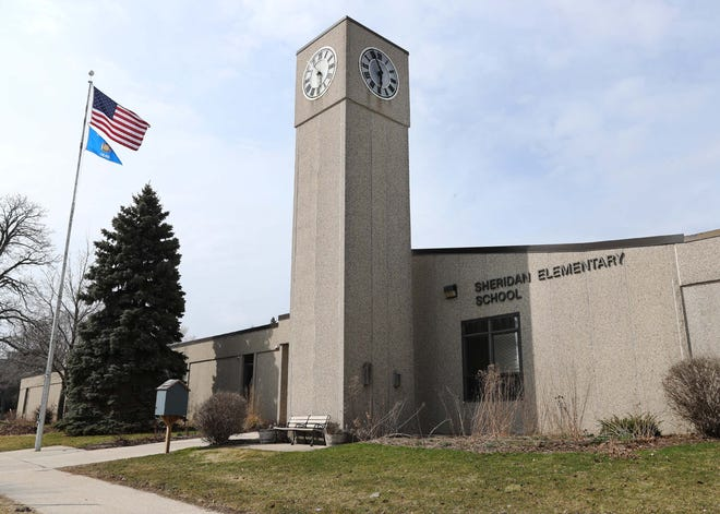 The exterior of Sheridan Elementary School as seen, Wednesday, March 25, 2020, in Sheboygan, Wis.