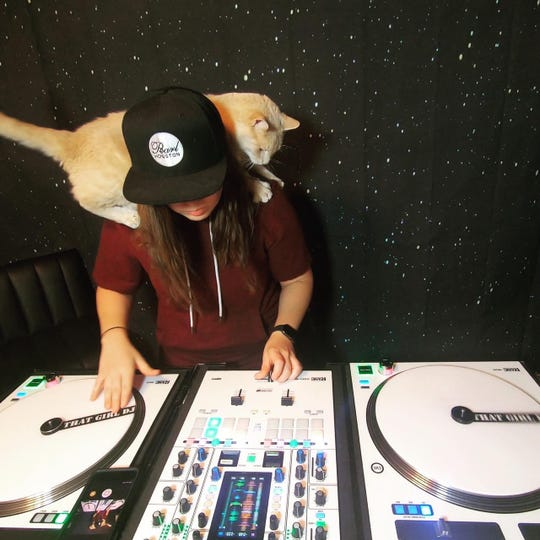 The Girl DJ (and her cat, Bruce Wayne) plays a set from her home during the coronavirus outbreak for audiences on social media.