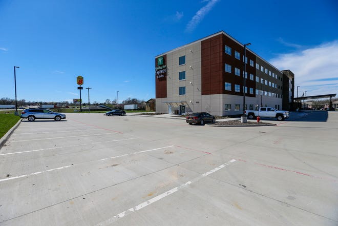 A mostly empty parking lot at the Holiday Inn Express at 3050 N Kentwood Ave. next to I-44.