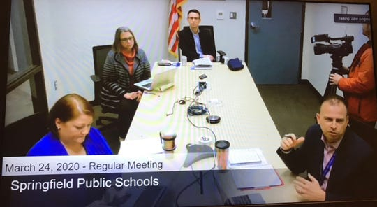The Springfield school board met Tuesday through video-conferencing. From left, Deputy Superintendent Carol Embree, Chief Human Resources Officer Penney Rector, Chief Communications Officer Stephen Hall, and Superintendent John Jungmann talked to board members.