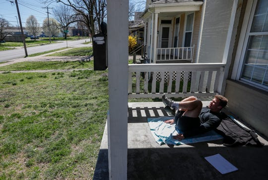 Benji Gormley works out on his front porch on March 25, the day before Springfield's stay-at-home order takes effect. Gormley said that his workouts were good meditation and that with the gyms closed, he was having to get creative with his workouts.