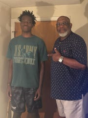 Ron Hill, right, with his nephew, Darius George. Hill, a Buffalo Gap graduate, died Tuesday from complications due to COVID-19.