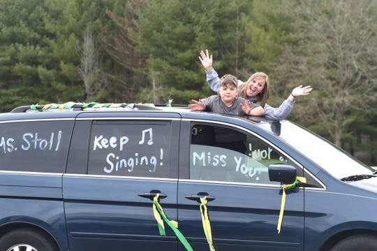"""Wilson Elementary School teachers and staff held a """"buzz by"""" Tuesday evening, driving through Fishersville-area neighborhoods to wave to students of the school."""