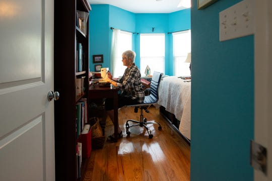 Anne Bewley works from her bedroom to sew fabric masks which she is donating to Allegro Senior Living Wednesday, March 25, 2020.