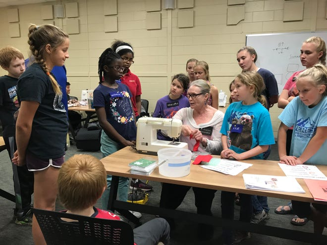 Volunteer club leader, Evelyn, provides instruction on a new skill during 4-H Stitch Stars Sewing Club.