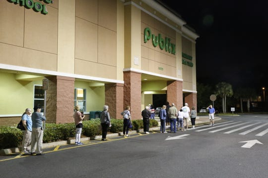 Senior citizens practice social distancing waiting for Publix to open.   Publix is one of many stores that have created special hours for senior citizens to shop during the COVID-19 pandemic.