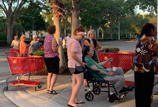 Shoppers line up outside Target early Wednesday, March 25, 2020, in Jensen Beach for the the first hour of shopping that the national chain has designated for each Wednesday for vulnerable guests. The hours for shopping on Wednesdays for those guests at Target are 8 a.m. - 9 a.m.