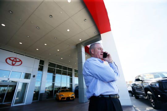 Gerald Miller, vice president of Poe Automotive, takes a call during the work day Wednesday, March 25, at Poe Toyota, 6330 Montana Ave., in El Paso. New and used car dealers can stay open under El Paso's  'Stay Home, Work Safe' order.
