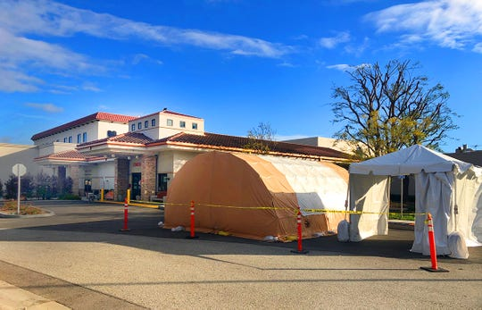 A triage tent has been erected at St. John's Pleasant Valley Hospital in Camarillo as part of planning for a possible surge in COVID-19 patients.