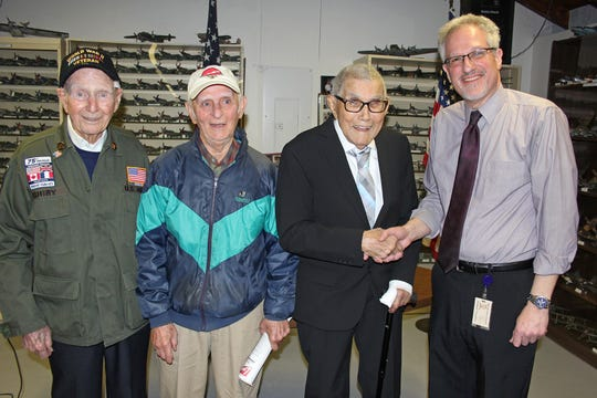 (From left) World War II veterans Tim Kiniry of Minotola, Stan Tarquinio of Bridgeton and Charley Pierce of Cedarville, and Robert Trivellini, vice president and educational coordinator for the Millville Army Air Field Museum, are pictured at the museum's Movie Night on March 10. Each of the veterans shared their experiences from the Battle of the Bulge.