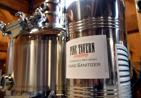 Bob Schmid and Bill Cox, owners of Pine Tavern Distillery in Monroeville, turned their production line from whiskey and vodka to hand sanitizer to help fight the COVID-19 coronavirus.