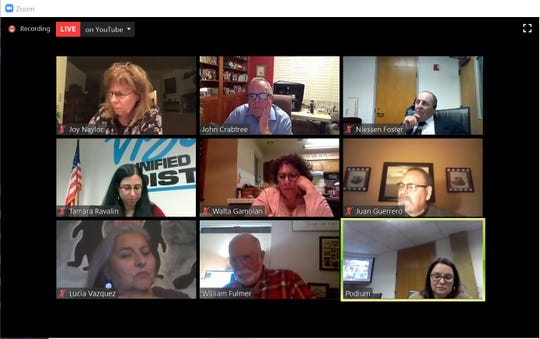 Visalia Unified School District trustees listen to a member of the public call in during a virtual board meeting on Tuesday, March 24, 2020. The meeting was held over Zoom and streamed on YouTube because of the global COVID-19 pandemic.