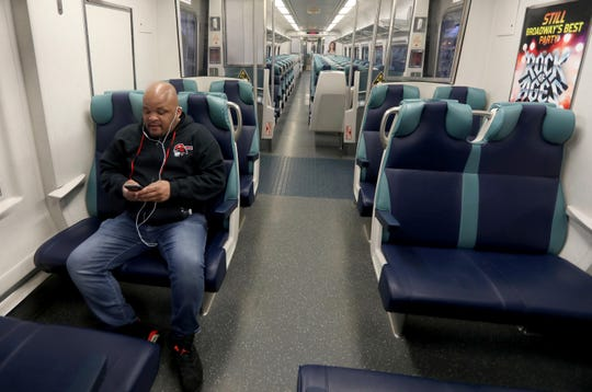 Troy Porter of Tarrytown, N.Y. rides a Metro-North train during the morning rush hour March 25, 2020. Porter, a custodian in the Yonkers Public Schools, rides Metro-North every day to the Yonkers station. He said that he is going into work every other day during the COVID-19 pandemic. Normally, he said 30 to 40 riders get on the 7:14 local train in Tarrytown. On this day, he was the only rider to get on.