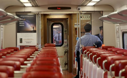As the coronavirus pandemic kept all but essential workers at home, conductors outnumbered passengers on one Metro-North Railroad New Haven Line train March 25, 2020.