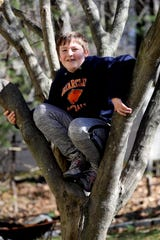 Joe Mulligan, 9, outside his home in Briarcliff Manor, N.Y. March 24, 2020. In October of 2019, Joe was diagnosed with EHE, a rare form of cancer. Other than regular scans to track the disease, there is no treatment for the cancer. During the coronavirus pandemic, Joe's parents, Jennifer and Jim, are afraid that he may not be able to get his regular scans as medical care may be diverted to those diagnosed with the virus.
