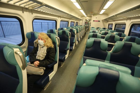 "Lori Glazer of Ossining, N.Y. rides the empty local 7:14 a.m.Metro-North train in to New York City during the morning rush hour March 25, 2020. Glazer in a registered nurse in the Children's Hospital at NewYork-Presbyterian/Columbia University Medical Center. She says that riding the empty trains is surreal during the COVID-19 pandemic and that it's scary going into the city because ""you never know when you're going to get sick""."
