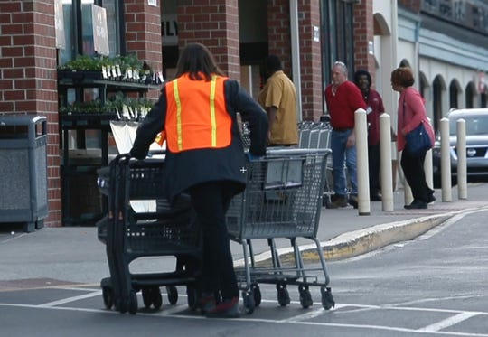 Shoppers and workers make their way through the ShopRite parking lot in Governor's Square in Bear early Tuesday evening.