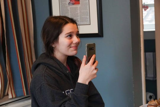 13-year-old Ellie, who is off from school because of the coronavirus outbreak, records a Facebook Live with her dad Wilmington chef Robert Lhulier as he does cooking demonstrations on using fresh vegetables in their home kitchen.