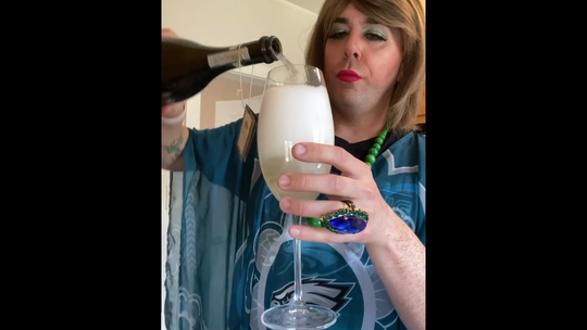 """Wilmington's Troy Hendrickson in character as Aunt Mary Pat DiSabatino making a """"quarantine mimosa"""" at home during a Tuesday live stream on Facebook, which was viewed more than 50,000 times."""