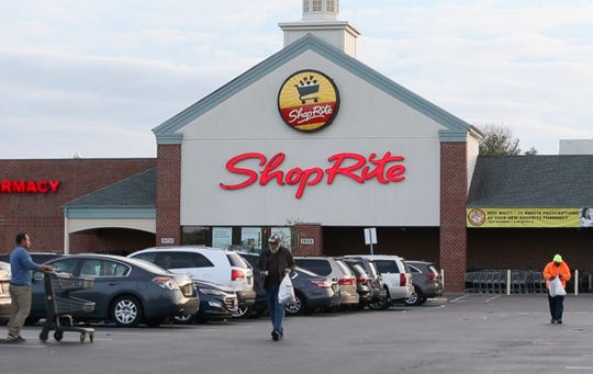 Shoppers make their way through the ShopRite parking lot in Governor's Square in Bear early Tuesday evening.
