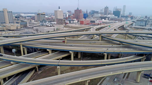 A low number of vehicles travel on a normally busy Marquette Interchange in Milwaukee on March 24, 2020. Scores of businesses will close for a month under a new order from Gov. Tony Evers aimed at keeping people in their homes to limit the spread of coronavirus in Wisconsin.