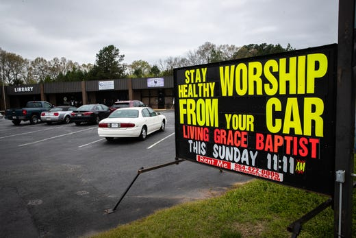 In response to the coronavirus outbreak, pastor Rex Simmons, of Living Grace Baptist Church in Piedmont, S. C. decided to have a drive-in style service so congregants could sit in their vehicles. Sunday, March 22, 2020.