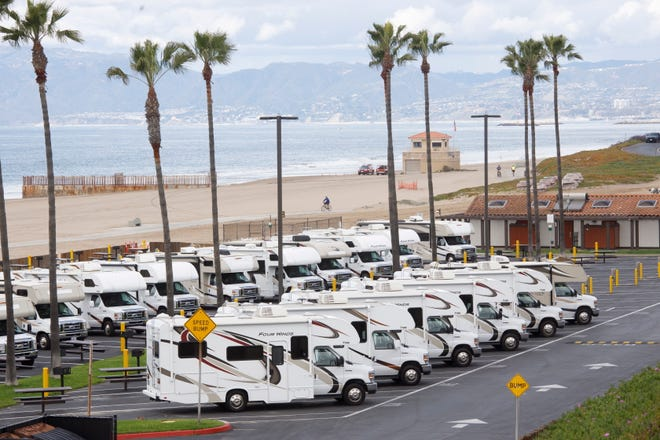 Los Angeles County has brought recreational vehicles to Dockweiler State Beach as housing for people under quarantine for the coronavirus.