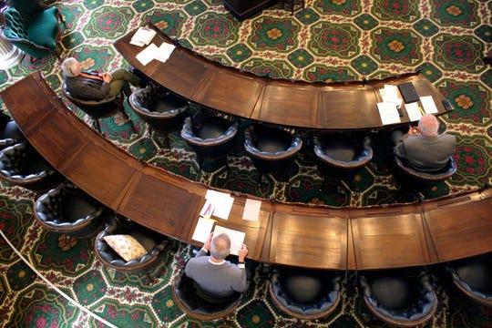 Vermont senators sit spaced apart to meet the social distance requirements set by the governor, Tuesday March 24, 2020, at the Statehouse in Montpelier, Vt. The Senate met with 17 members, one over the required quorum, to pass legislation needed to confront the coronavirus pandemic.