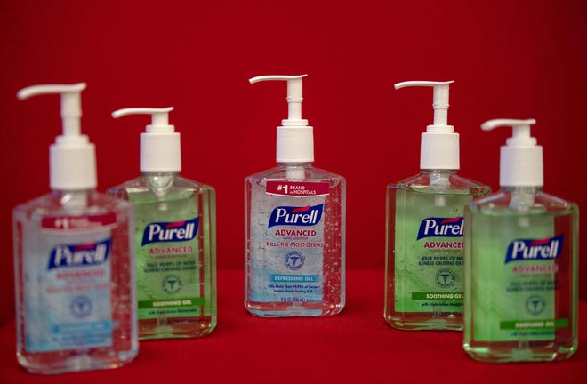 This photo illustration shows bottles of Purell hand sanitizers which are selling for inflated prices on the internet.