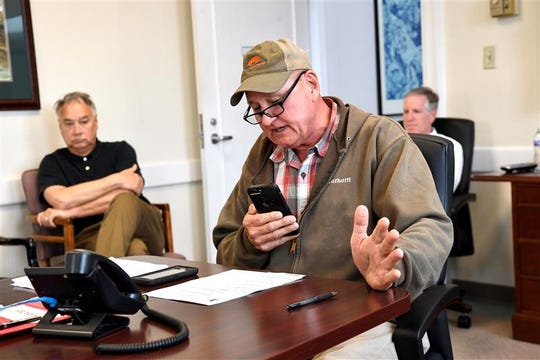 Chairman Tommy Dunn leads an emergency meeting conference call with council members in the county conference room in Anderson Thursday.