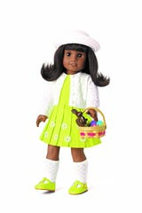 Melody, the doll from the 1960s in American Girl's historic BeForever line, looks crisp in her Easter best.
