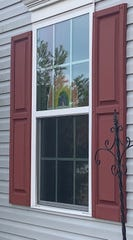 A rainbow in a Barnegat window, part of an unofficial #RainbowTrail.