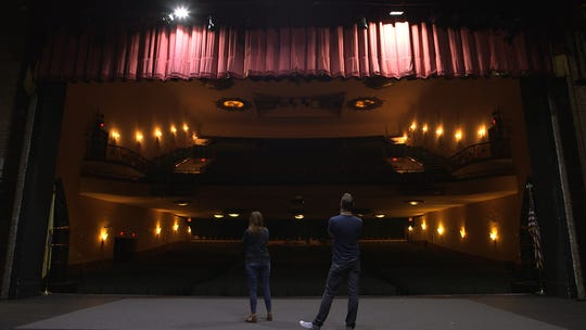 """Paranormal investigators Adam Berry and Amy Bruni size up Asbury Park's haunted Paramount Theatre from the stage on which countless performers have bared their souls over the decades in a scene from """"Kindred Spirits."""""""