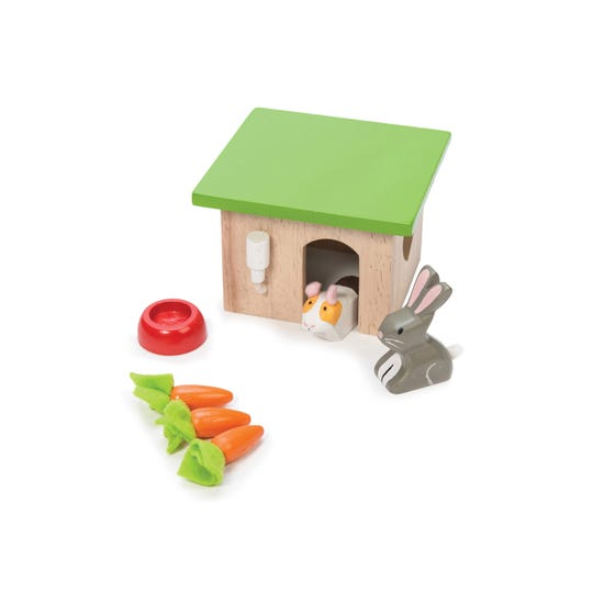 A guinea pig and bunny hutch, part of a collection of wooden toys designed in Great Britain by Le Toy Van.