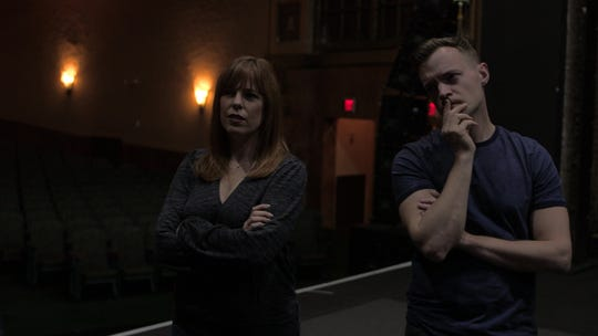 """Paranormal investigators Amy Bruni and Adam Berry listen as techincal director Jason Dermer describes the puzzling activity plaguing Asbury Park's Paramount Theatre in a scene from """"Kindred Spirits."""""""