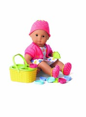 Bitty Baby wears her Berry Adorable Strawberry outfit, by American Girl.