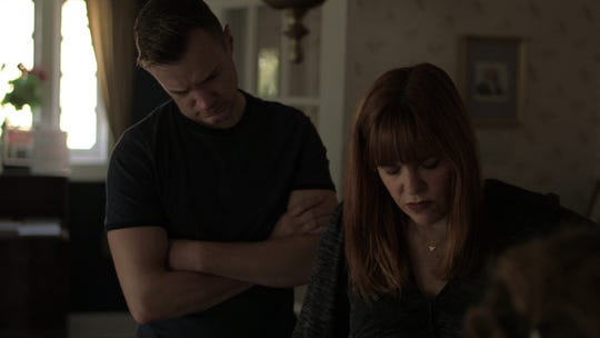 """Paranormal investigators Adam Berry and Amy Bruni study the names of those who perished in the Morro Castle shipwreck off Asbury Park's boardwalk in 1934 hoping to find some piece of evidence of who is haunting this historic space in a scene from """"Kindred Spirits."""""""