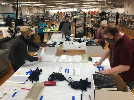 Empoyees at Kitsbow Cycling Apparel in Old Fort create face shields for medical workers and first responders. The company has switched from manufacturing bike apparel to PPE in light of the coronavirus pandemic.